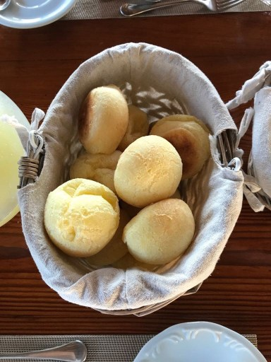 a basket of brazilian pao de queijo cheese bread