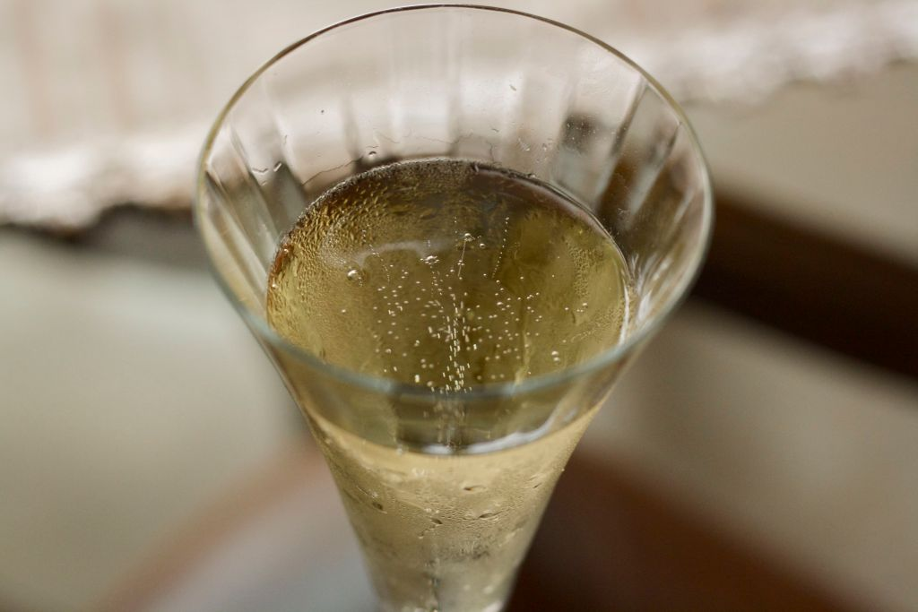 Close up of cava sparkling wine in champagne flute.