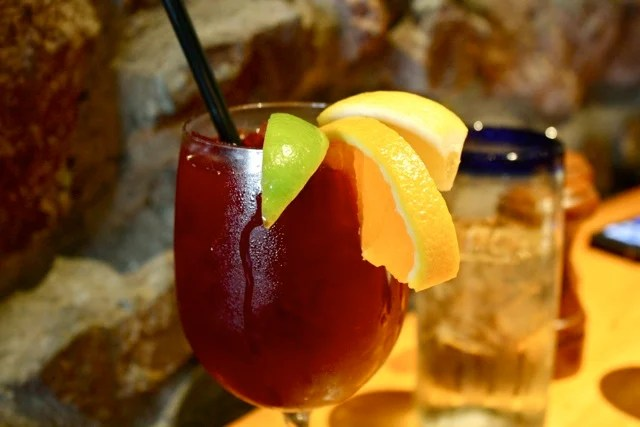 Red sangria in glass on restaurant table from Edible Times