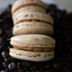 Coffee macarons on bed of espresso beans
