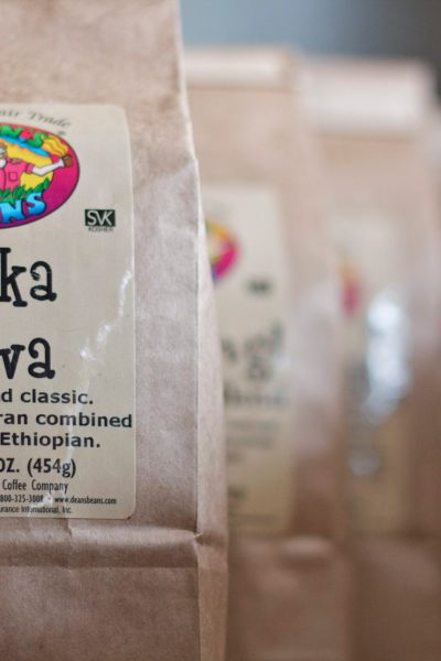 Bags of Dean's Beans fair trade coffee in a row