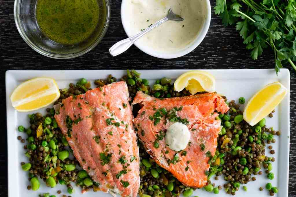 Grilled and baked sockeye salmon on plae with vegetables and dijonnaise