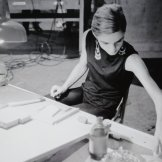 photo of Edie Sedgwick at a drawing table