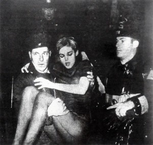 black-and-white newspaper photograph of George Gekrish carrying Edith Sedgewych (Edie Sedgwick) out from apartment fire