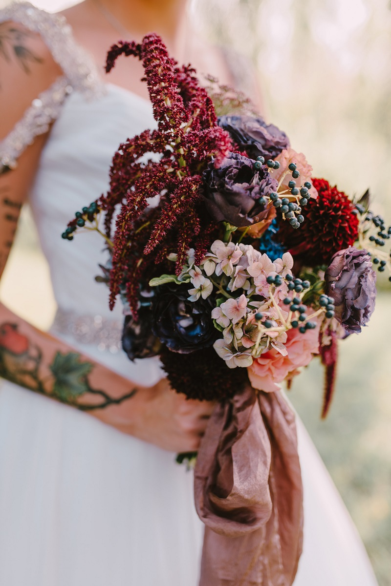Dark colored flowers in a bridal bouquet