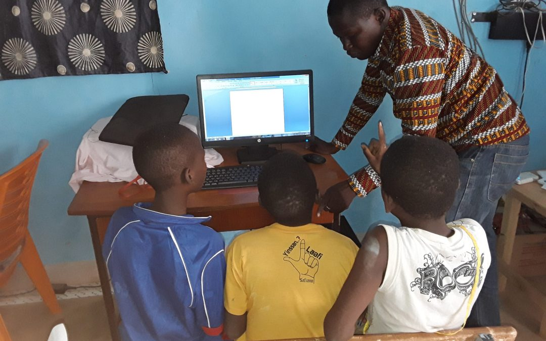 Students with teacher in computer lab in Burkina Faso school