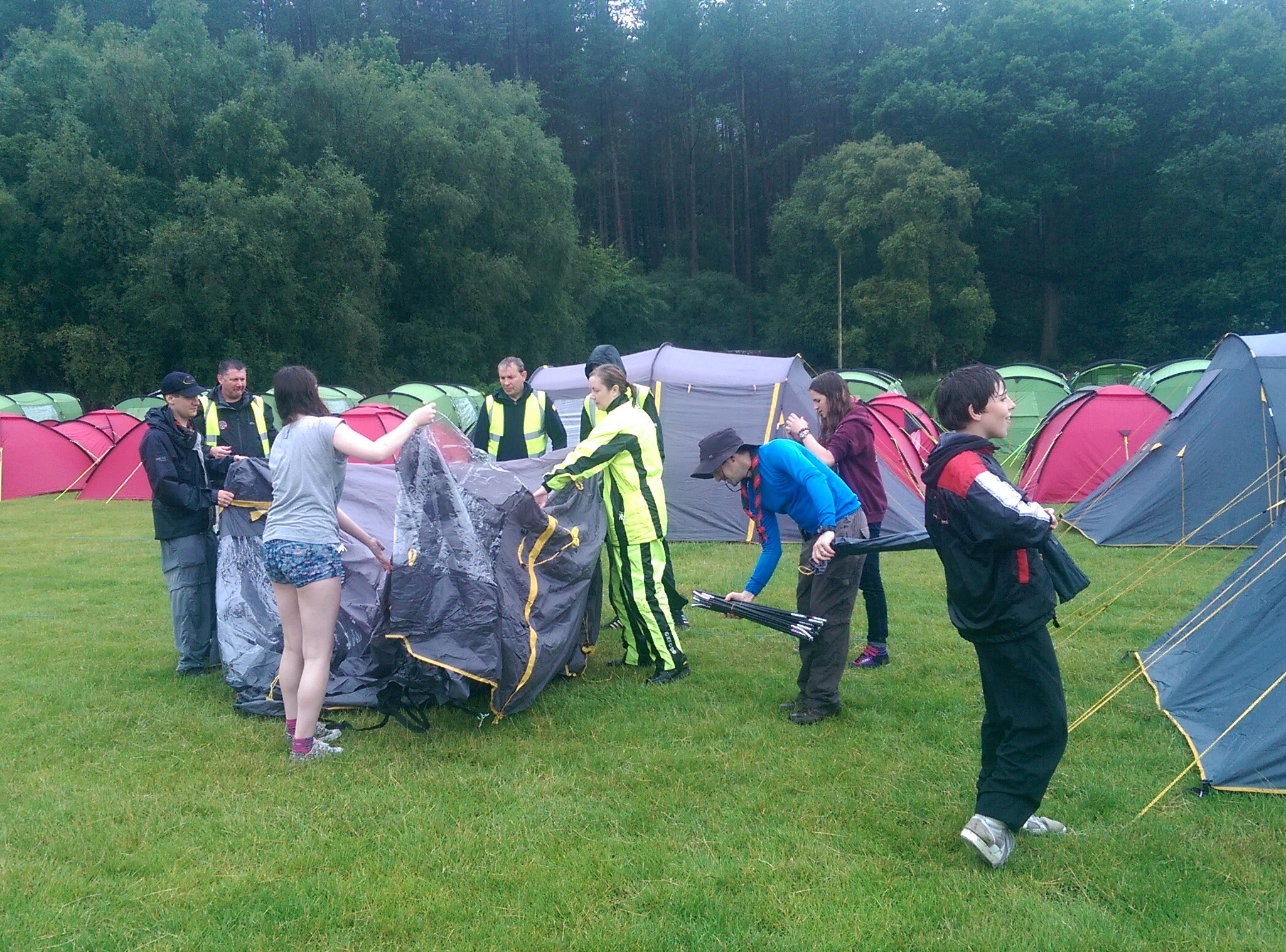 The Team putting up some of the Pre-pitched Tents - come rain or shine!