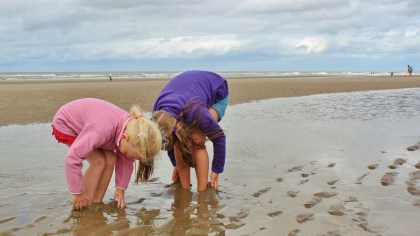 Children playing in sea - Edinburgh Festival Camping