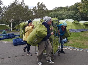 The Edinburgh Festival Camping crew moving the tents to begin set up