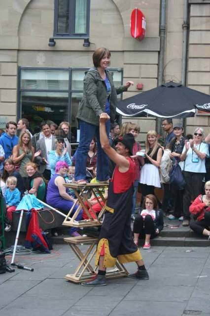 Audience Participation in Fire Juggling Slack Rope Act at Edinburgh Fringe