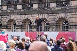 Bustling Streets of Edinburgh with Street Performers