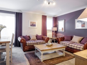 Botanist Apartment formerly named Parkgate Residence Living and Dining Room showing sofas dining table and chairs