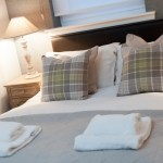 double bedroom neutrals and green plaids