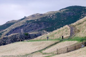 Arthur's seat showing people walking