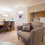 The Malt Kiln Apartment Edinburgh formerly McDonald Residence living room showing dining table and kitchen