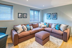 inviting corner sofa with cushions piled high in holiday apartment Edinburgh Old Town