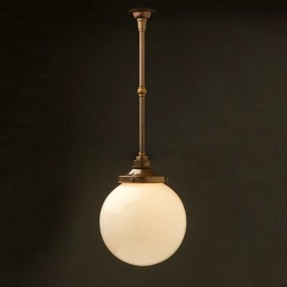 Spherical opal glass brass fixed rod light antique brass