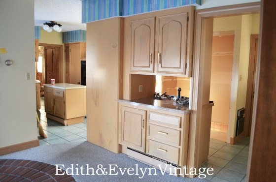 This cabinet sat right in the middle of the kitchen and gave it a very tight, closed in feeling.  It has to go!