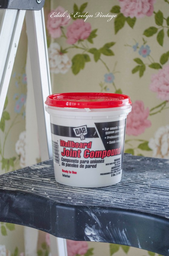 Joint compound to cover the seams in the wallpaper.