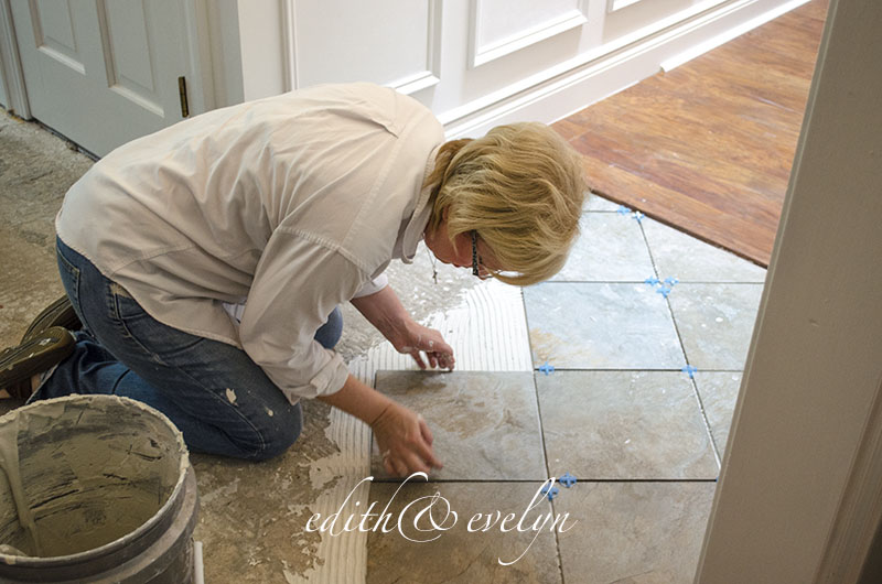 Laying Tile in the Foyer   Edith & Evelyn Vintage   www.edithandevelynvintage.com