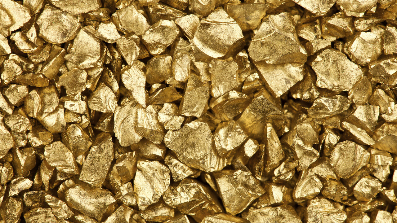 gold turns positive post