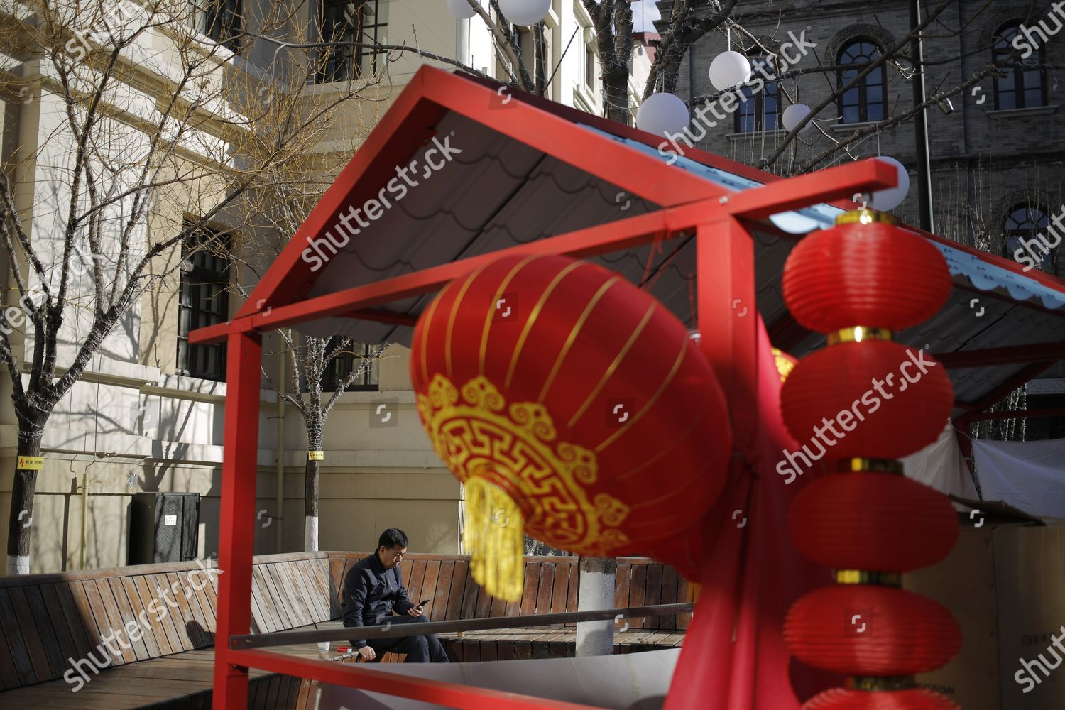 man rests on chair Qianmen area during Editorial Stock Photo ...