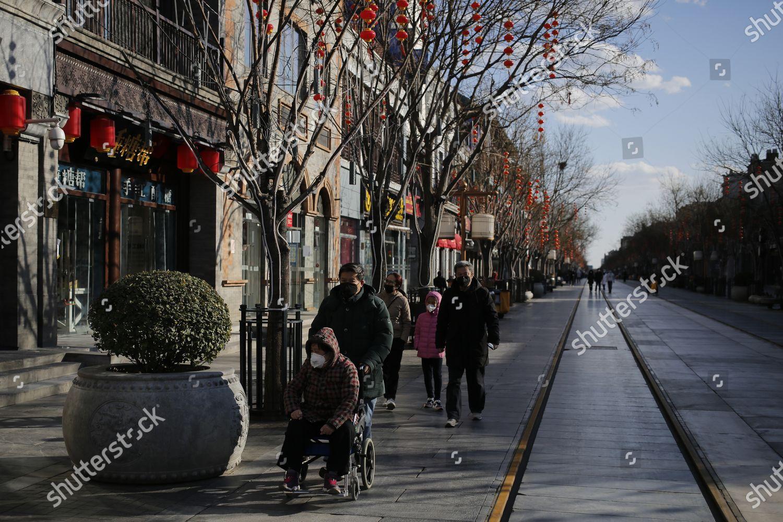 People wearing protective masks walk Qianmen area Editorial Stock ...