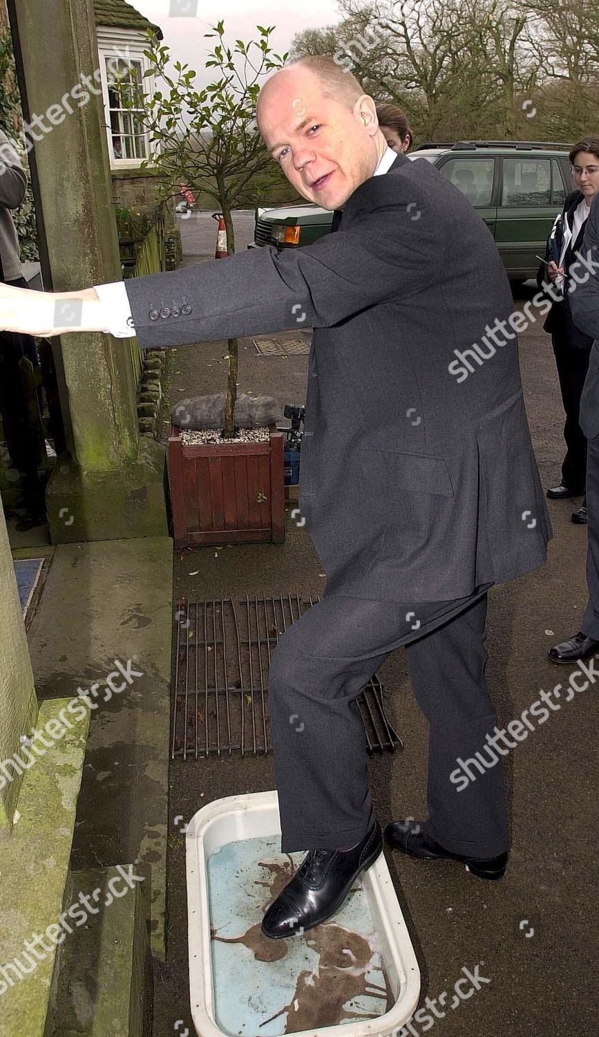 William Hague Disinfects His Shoes Before Entering Editorial