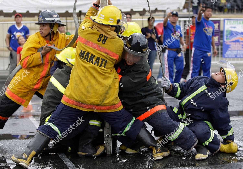 filipino firemen position themselves