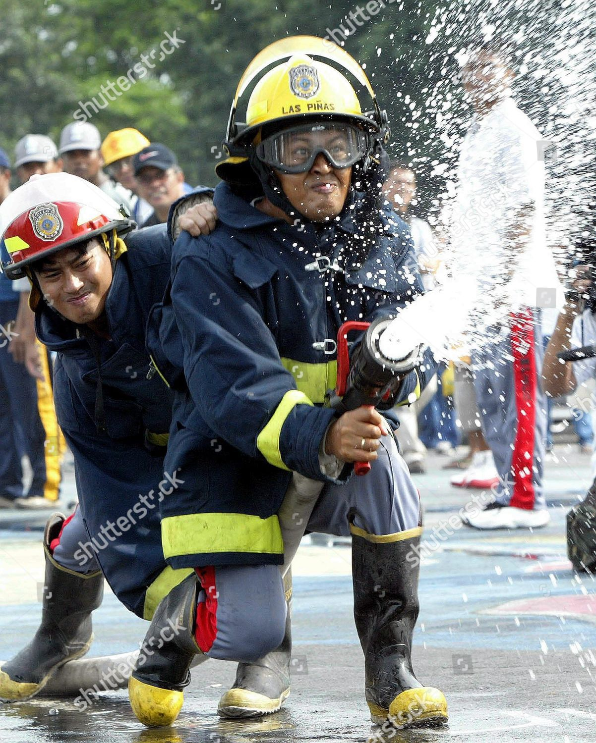 firefighters try control water