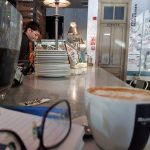 a day in the life of a writer in Spain cafe in madrid spain with coffee cup and glasses