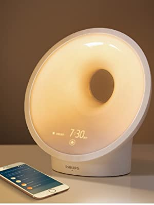 Philips SmartSleep Connect on a bedside table for better sleep
