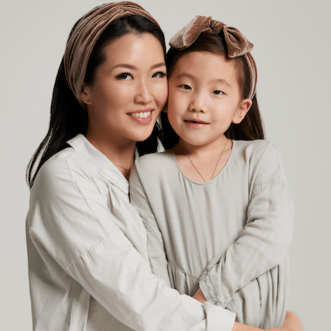 mom and daughter wearing the ai Mother's Day headband collection