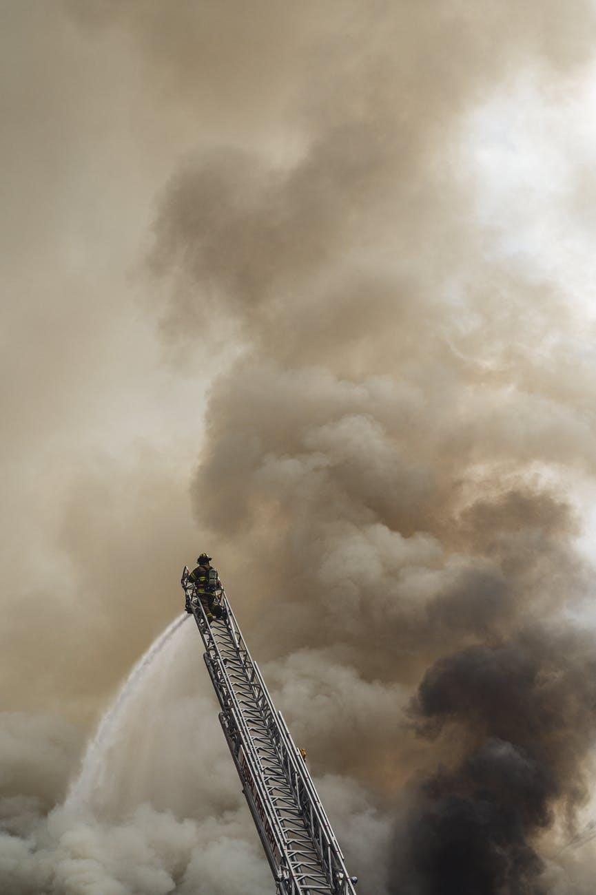 fireman on top of a ladder
