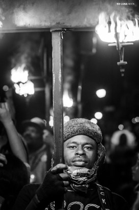 Flambeau carrier. Knights of Chaos parade. New Orleans. February, 2013.
