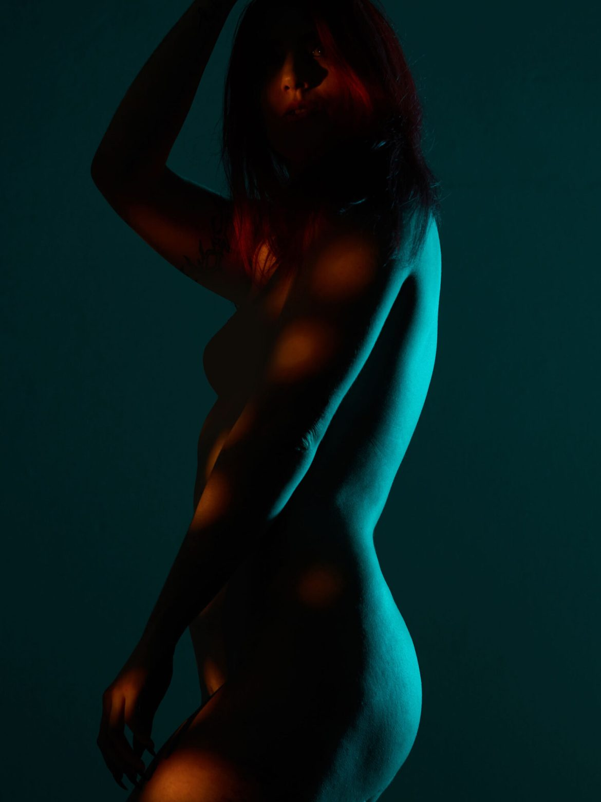 beauty of woman body in dramatic Lighting