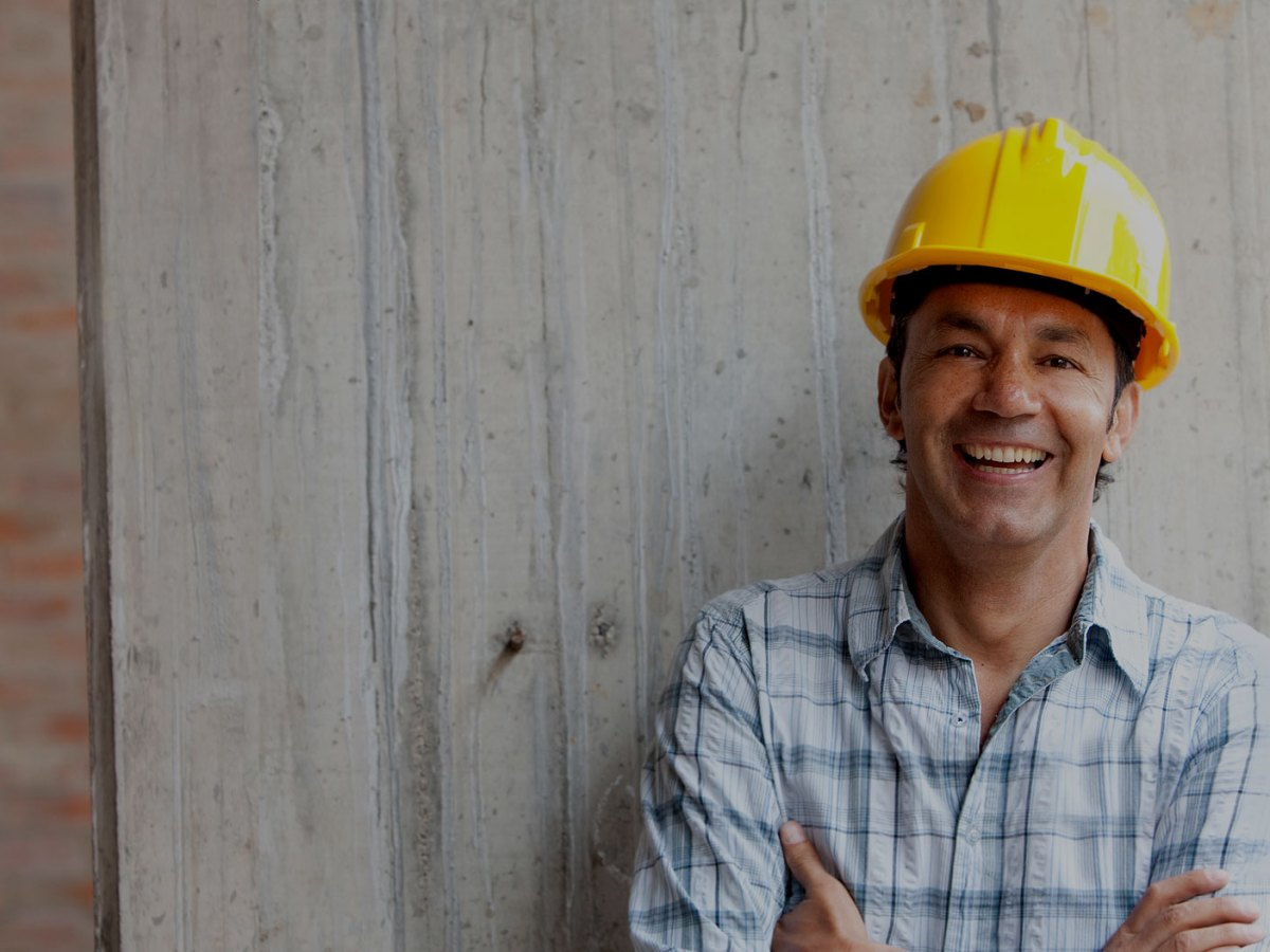 smiling construction business owner wearing hardhat
