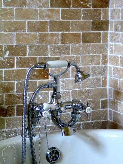 The aricot en suite with Travatine tiles