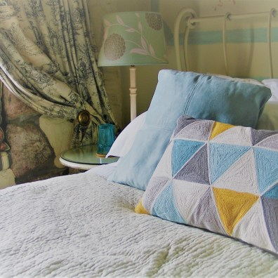 luxury bed and breakfast embroidered cushions to dress the bed