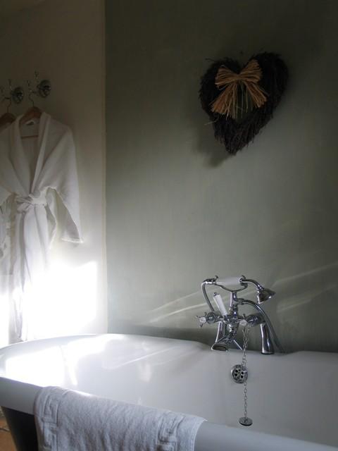 Roll topped bath and bathrobes in a sunny bathroom