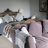A vintage walnut French bed - try adding a squashy sofa and cosy throw