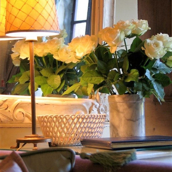 silk lampshade and white roses interior photo