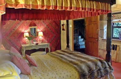 Hand carved four poster bed at Ednovean Farm -great for an anniversary treat