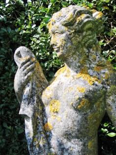 Garden statue covered in lichen