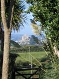 St Michael's mount in west cornwall framed by a garden gateway