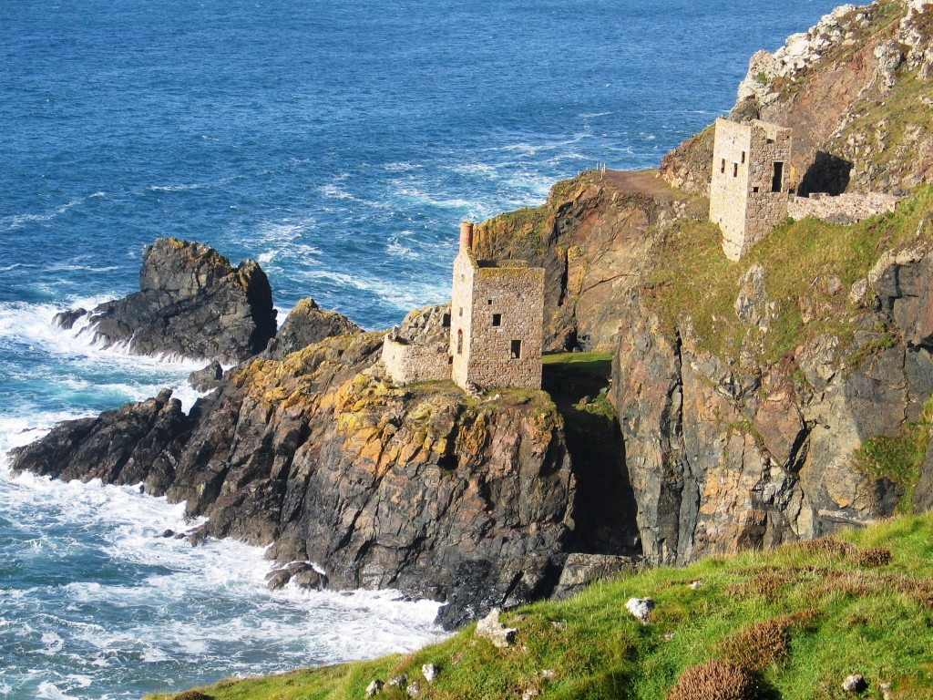 The lower and upper engine houses The Crowns Botallack clinging to the cliffs above the sea