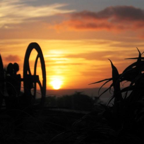 Old farm pump at sunset