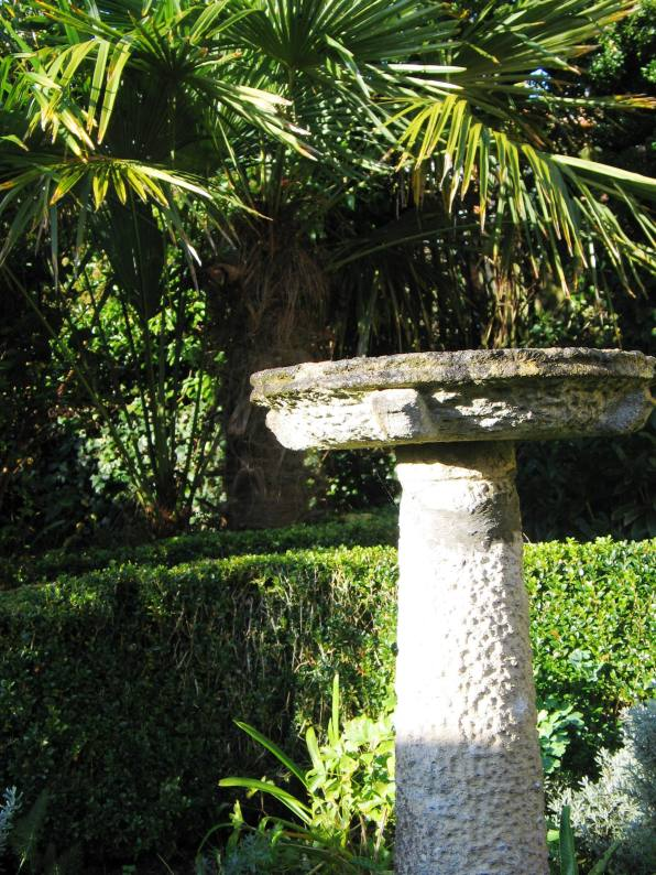 Always popular with the birds this hand carved bird bath sits in a little herb garden