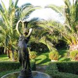 Ednovean Farm's formal parterre and fountain backed by Date Palms