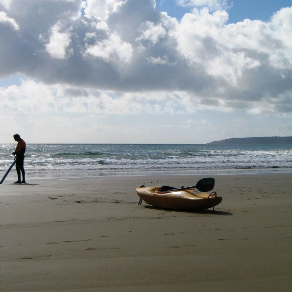a Lonely canoe waiting on the sands